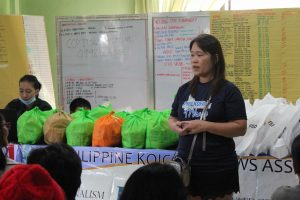 Ms Gina P Borinaga, Philkofa Pres delivering message to the recipient families