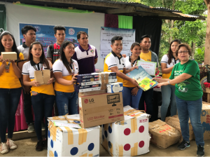 PhilKOFA Vice President for Mindanao Marizon S. Loreto turns over the books donated by Adarna House, a publisher of children's books.