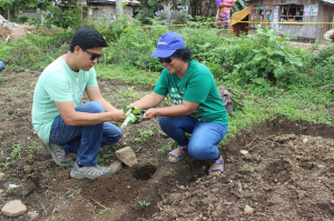 PhilKOFAn Eileen Estrada and Hon. Jabib V. Bides, Jr. spearhead the tree planting activity within the Datal Biao Integrated Elementary School premises.