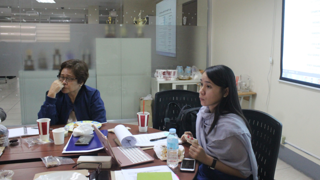 Ms. Maria Regina P. Arquiza, interim KOICA Project Officer, explaining the new KOICA Guidelines and required forms to the PhilKOFA Board of Trustees. Ms. Marizon Loreto, Vice President for Mindanao, listens intently.