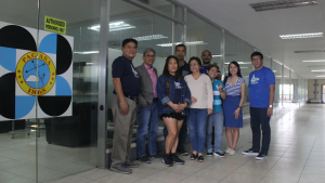 The Board of Trustees, with Ms. Maria Regina Arquiza, taking a group photo at the meeting venue entrance.