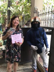 Ms. Pinky Sevilla receives her protective mask and vegetable seeds from PhilKOFA